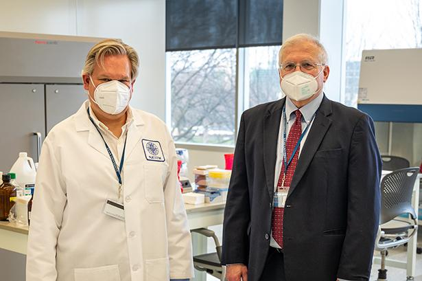 Robert Pyatt, Ph.D., and Keith Bostian, Ph.D., in the CLIA Covid lab at Kean University