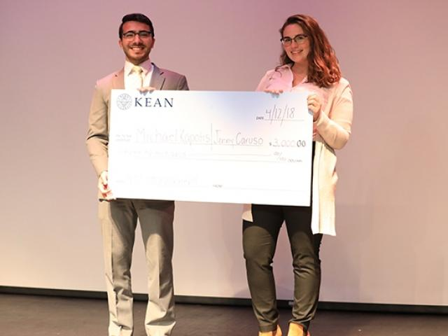 Kean business students pose with the $3,000 prize they received at the Kean Business Plan Competition.