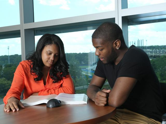 Kean students study together at a desk.
