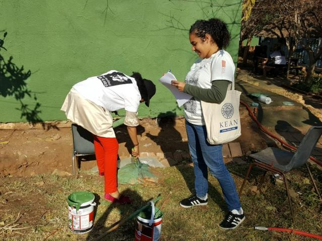 Kean student Natalie Hernández interviews a volunteer in South Africa.