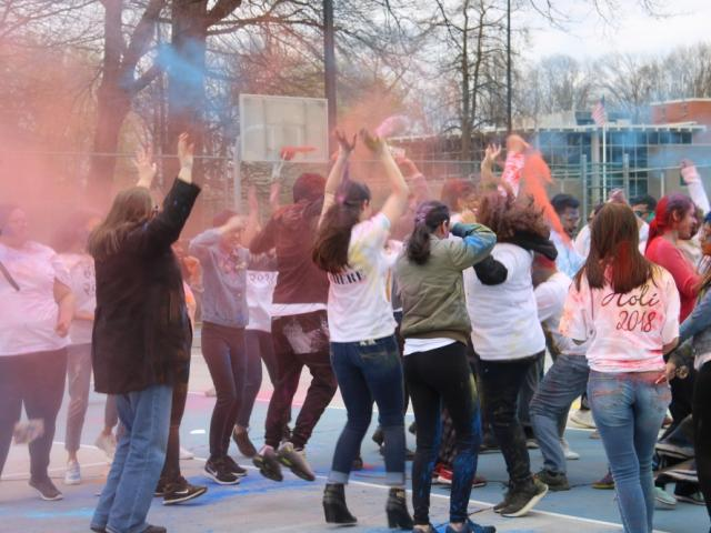 Holi Festival 2018 at Kean University, Students with spray colors dancing