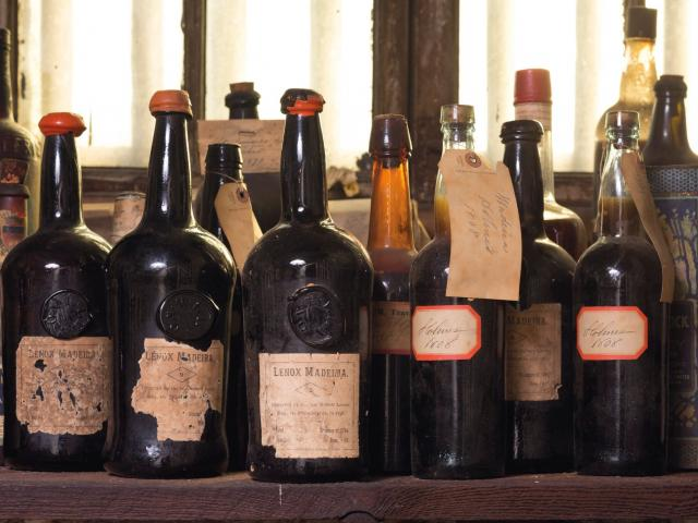 Hand written tags and labels adorned the fine of ancient Madeira wine