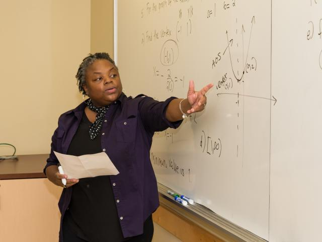 Kean adjunct math professor Irisa Leverette instructs students in algebra.