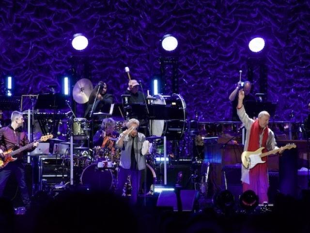 Rock band The Who on stage at MSG. Pete Townshend is seen doing signature move. Kean Adjunct James Musto III plays percussion in the background.