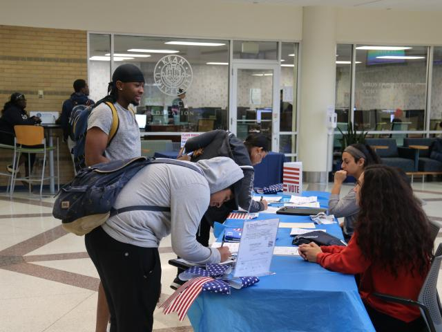 Students register to vote at a Kean University event.