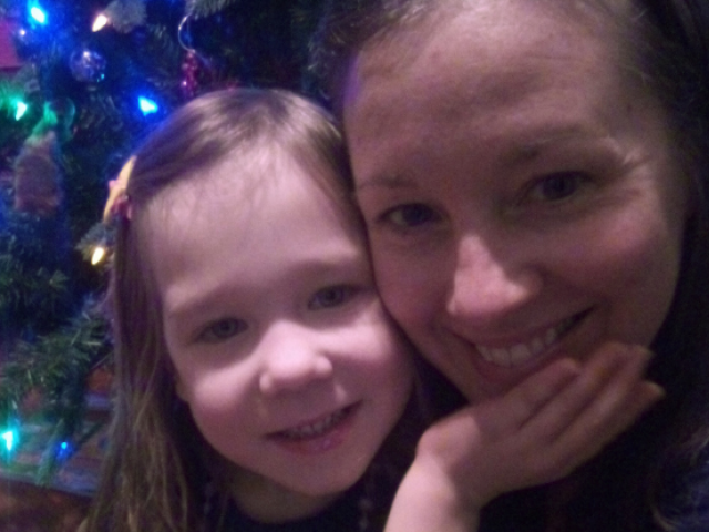 Suzanne Barich and her daughter, Addison, taking a Christmas photo.