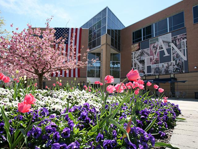 Miron Student Center surrounded by flowers in the spring time.