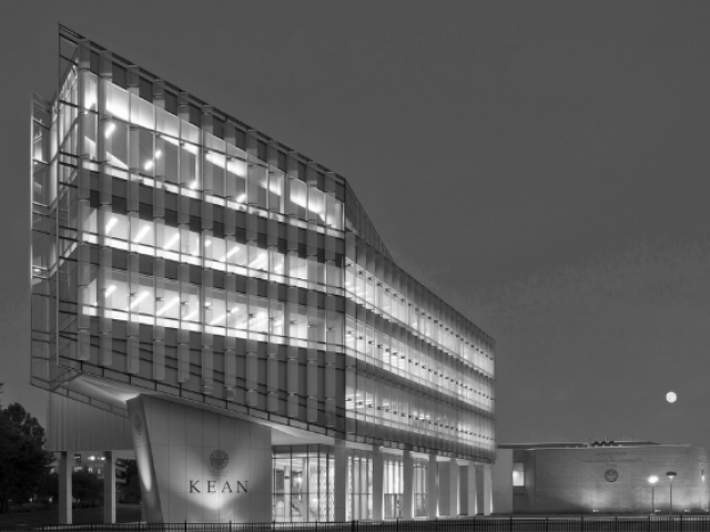 Kean University's STEM building illuminated at night.
