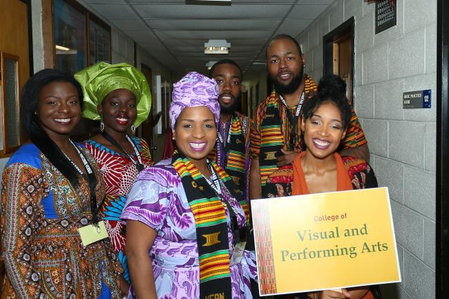 students pose in photo for african heritage commencement at kean