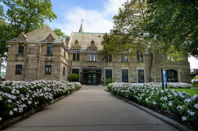 Kean Hall front entrance with flowers