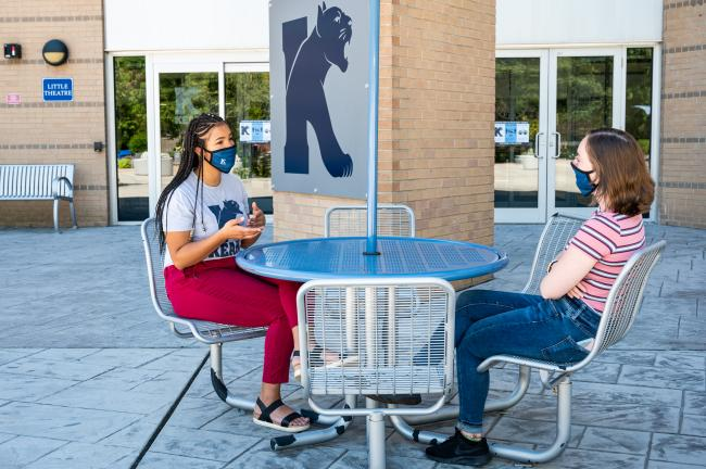Kean students converse on the MSC patio