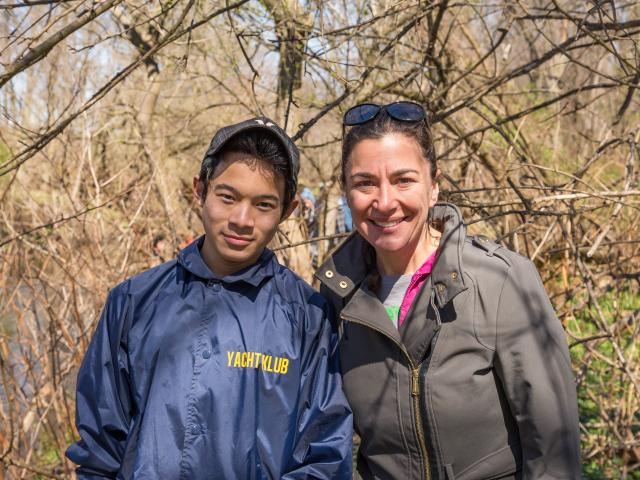 Professor Daniela Shebitz cleans up local river with students on Earth Day.