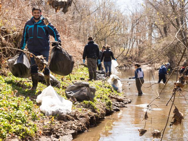 Science students clean up local river on Earth Day