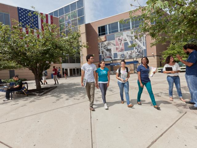 four students walking on Kean University's campus