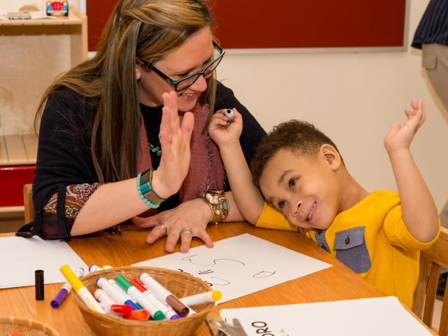 Kean student works with a young boy in the Kean Child Care Center