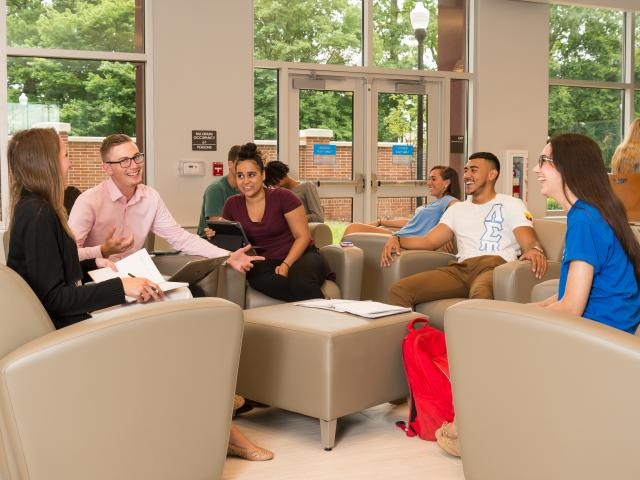 Kean University students inside residence hall at seating area
