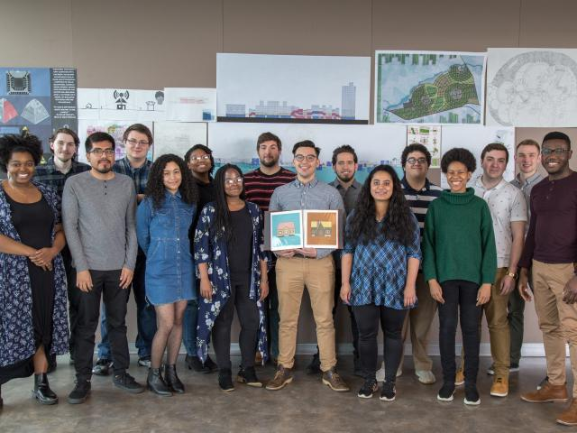 Kean Architecture students pose with architectural renderings