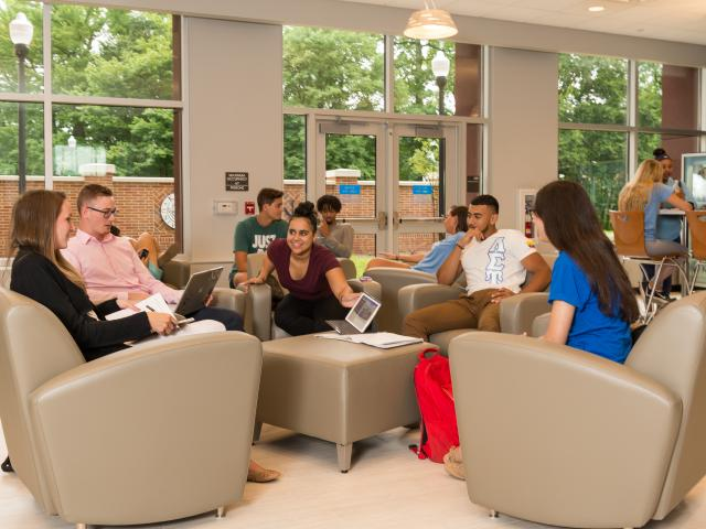 Resident student congregate in a lounge area