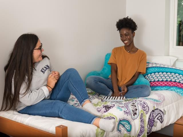 Roommates laugh in a Residence Hall room