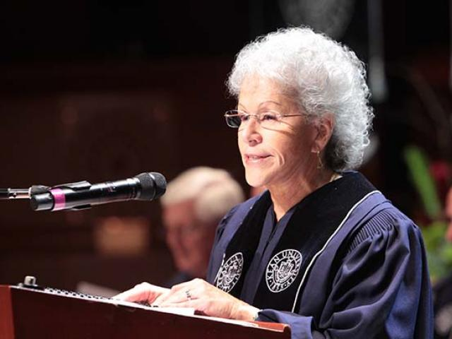 Former Kean University Board of Trustees chair Ada Morell speaks at a podium at Kean's commencement.