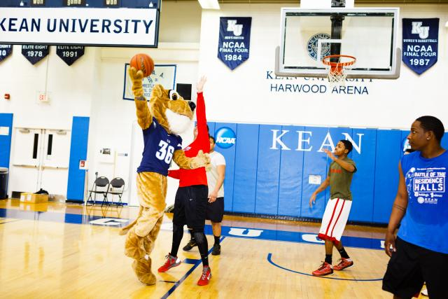 Kean University cougar playing basketball