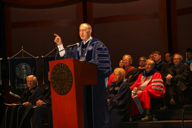 President Farahi speaking at Commencement