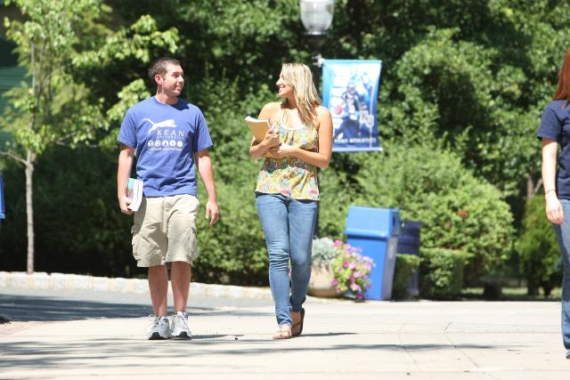 Two Kean University students on walking on campus