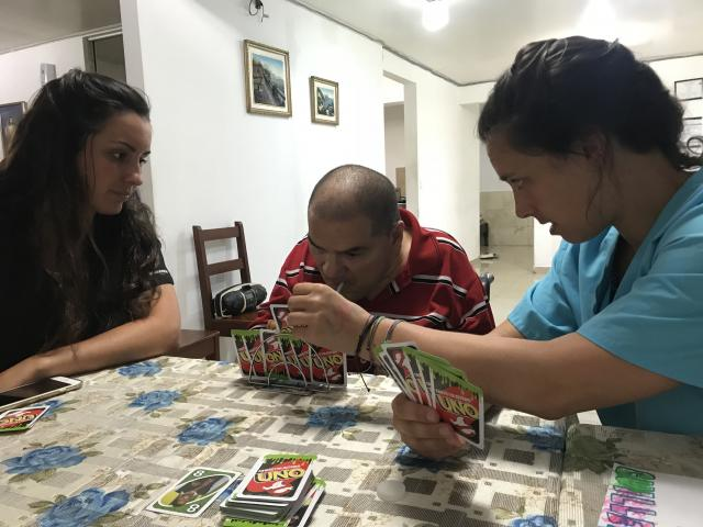 Two Kean occupational therapy students work with a client in Costa Rica.