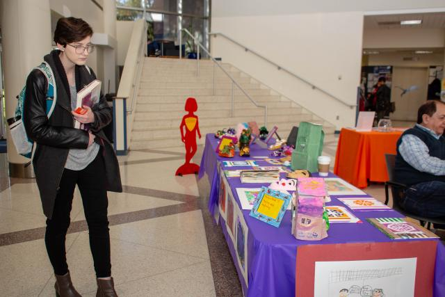 A Kean student looks at the art display of children's artwork that were victims of domestic violence.