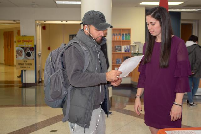 Kathryn Lynch, director of community support services at YWCA speaks with a Kean student about the resources available through the YWCA.