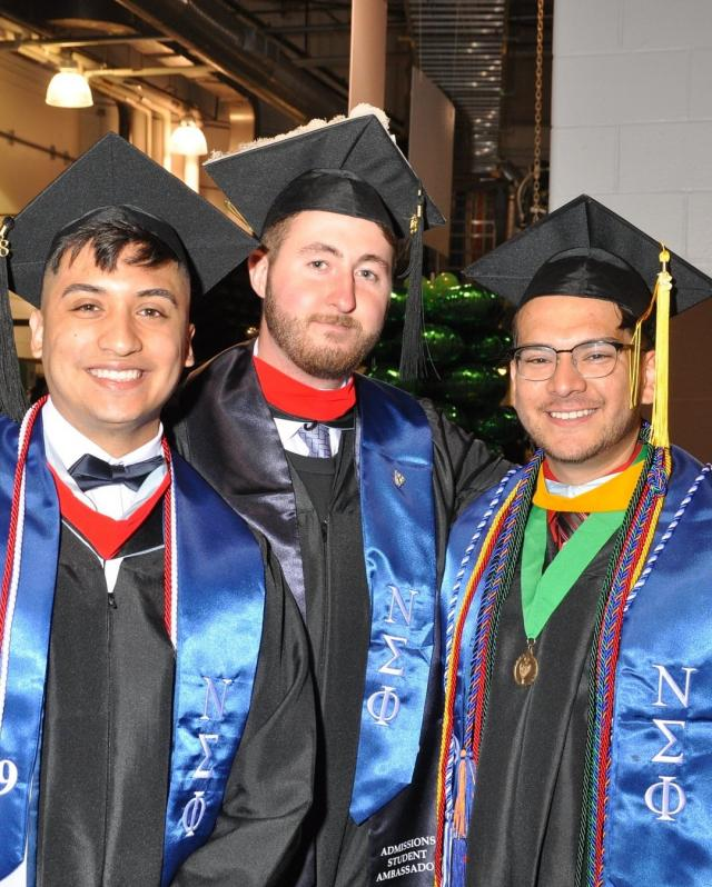 Kean students pose at their May 2018 commencement.