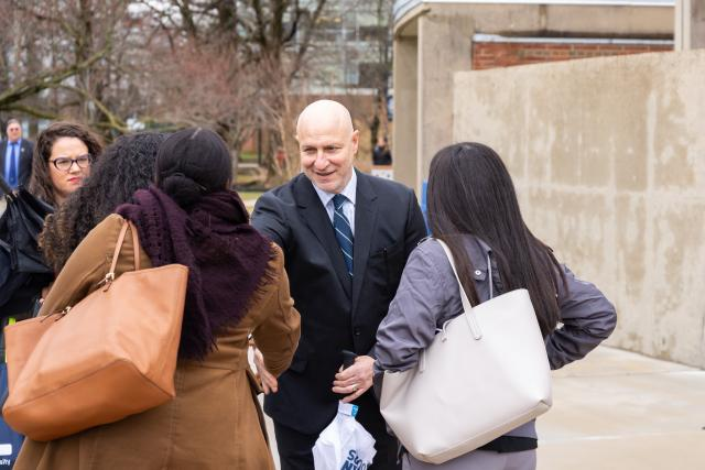 Chef Tom Colicchio talks with three Kean University students on the Union campus.