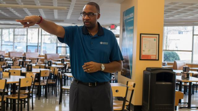 In the MSC Food Court, Kerrin Lyles points out where the new Asian food station will be