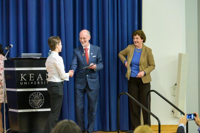 Student accepts award from Dr. Toney