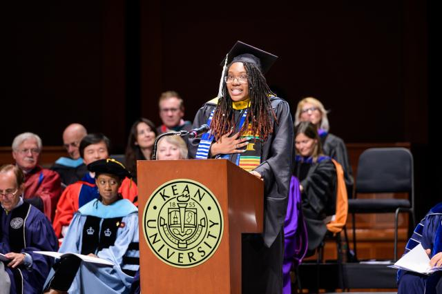 Student of Distinction Nasya Hammond-Watson speaks at the Nathan Weiss Graduate Commencement