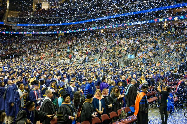 Confetti fills Prudential Center at the close of the Undergraduate Commencement ceremony.