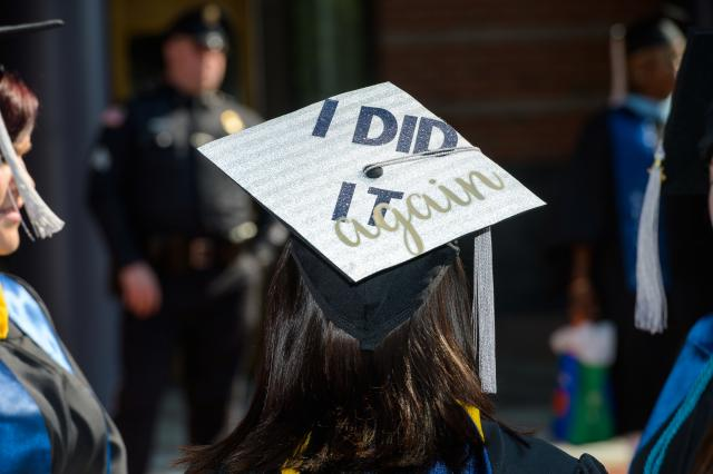 "The cap of a graduating Kean University graduate student with the words, ""I did it again."""