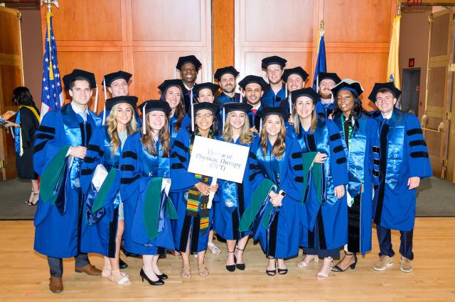 The first class of Doctor of Physical Therapy students poses at commencement.