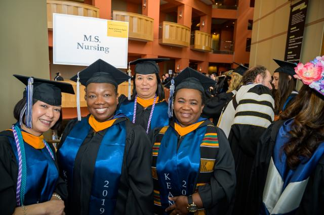 Kean students receiving a master's degree in nursing pose together.