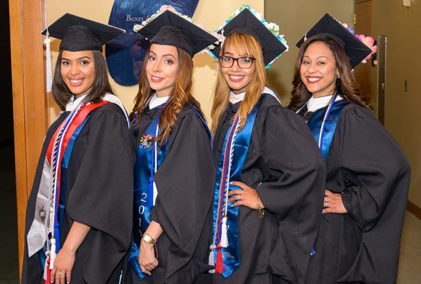 Four women graduating from Kean University's Nathan Weiss Graduate Program pose together.
