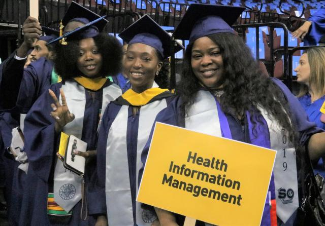 Photo of Health Information Management students about to graduate