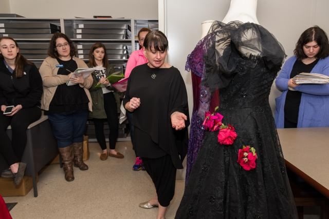 Beth Dincuff guides her class through Liberty Hall's dress archives.