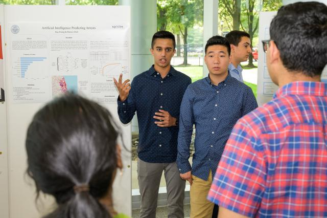 Students Manan Shah of Edison, and Ray Zhang of East Brunswick, present their research.
