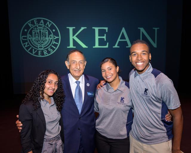 Kean President Dawood Farahi poses with Kean students.