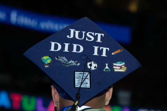 "A Kean University commencement cap with the words, ""Just did it."""
