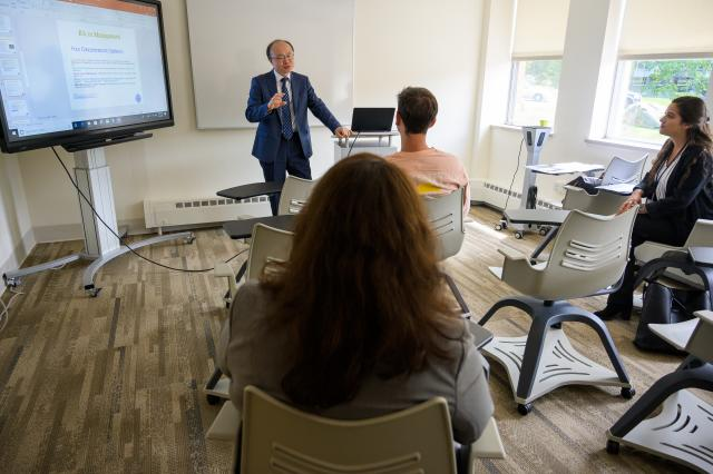 Kean Professor Shanggeun Rhee teaches a business class at Skylands.