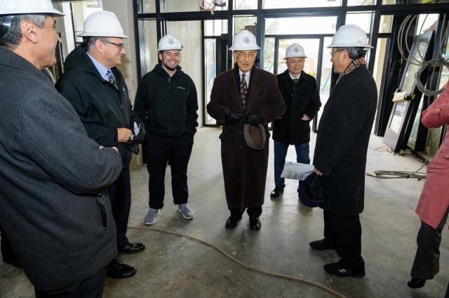 President Dawood Farahi, Ph.D. and others at Hynes Hall Sneak Peak