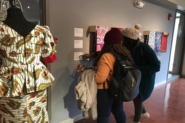 Students examining African Prints, 2017