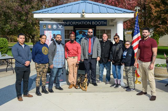 Kean Student-veteran Jason Pryor, in red shirt, received a K-9 service dog