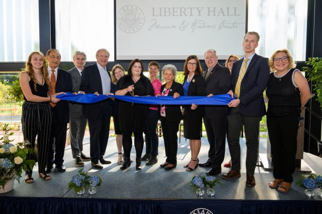 Group image of students and leadership at the ribbon cutting ceremony for Liberty Hall Academic Center
